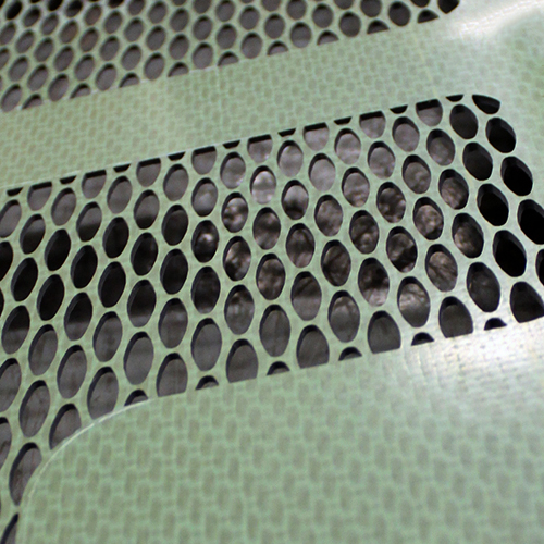 Carbon Fiber Composite featuring non-traditional perforation | Precision Abrasive Machining®